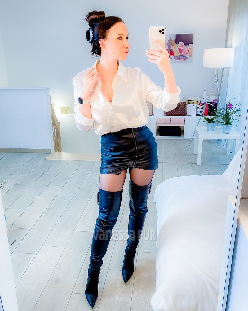 Enjoying leather boots and a too short skirt with satin blouse this evening